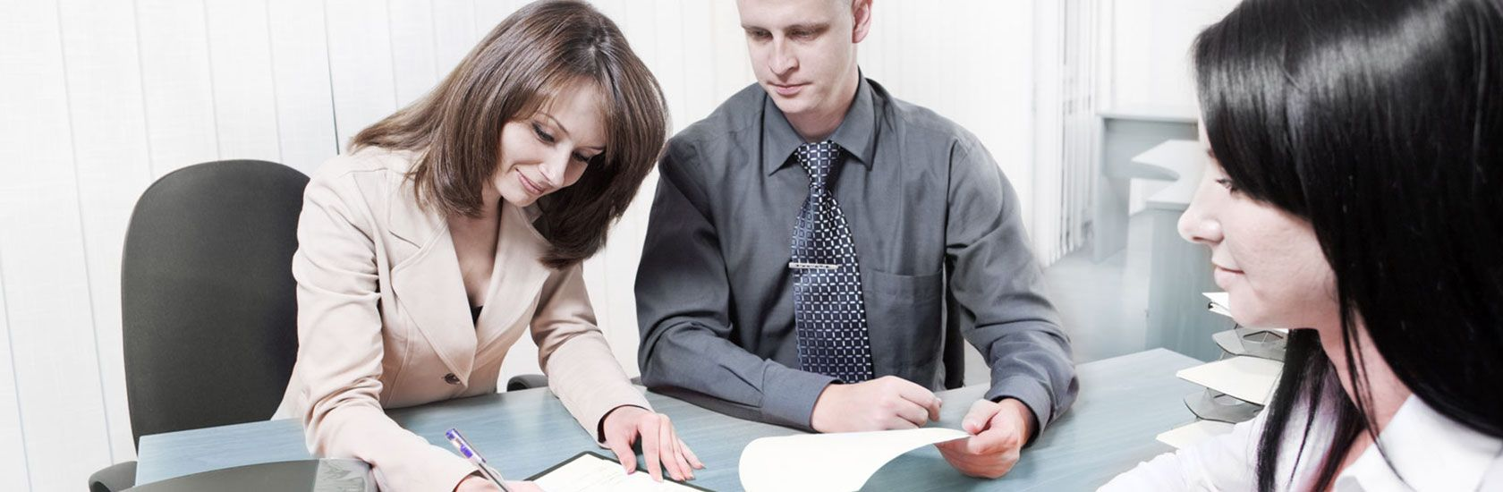 Couple client with female lawyer signing paper